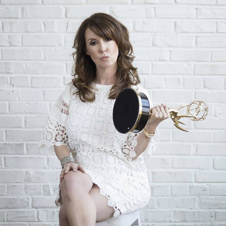 TV Producer Donna Benner Holding Her Emmy at Photographer Whitney Thomas' Philly Studio