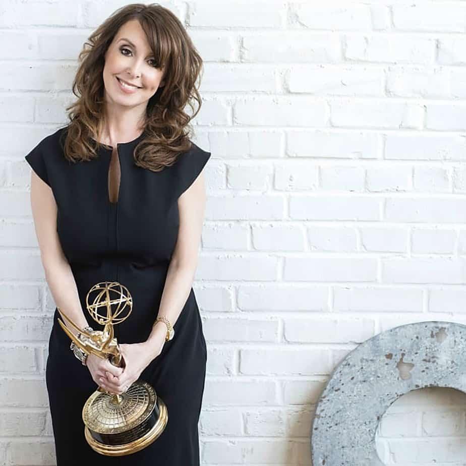 Talk Show Producer Donna Benner Holding Her Emmy Award