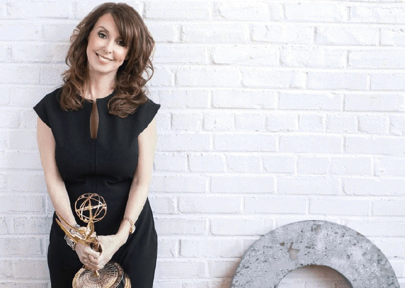 Donna Benner - TV Producer & Founder of Swoon Talent holding an Emmy Award