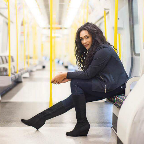 Swoon Talent - International Travel Expert Sandra McLemore on the tube at Tower of London Station