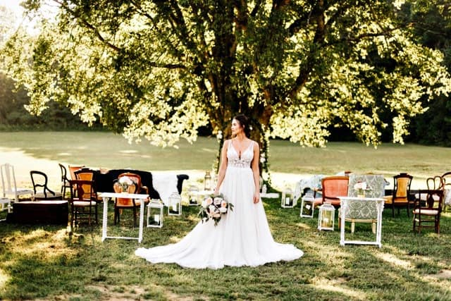 Bride on the grounds of the old southern charm outdoor wedding venue in Oxford, North Carolina owned by Britnye & Cody Shore