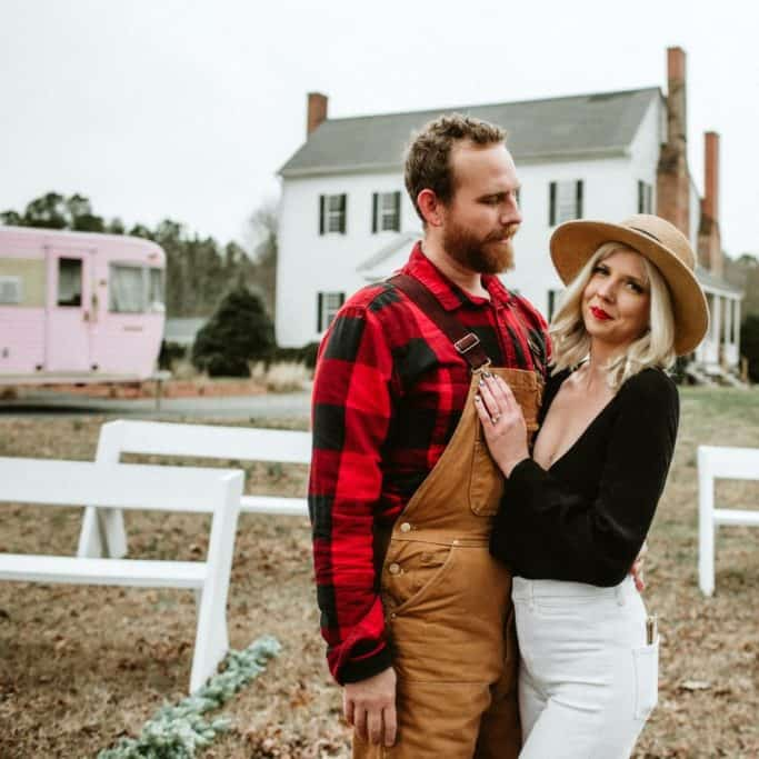 Britnye & Cody Shore pose in front of their famed farmhouse, a popular wedding venue