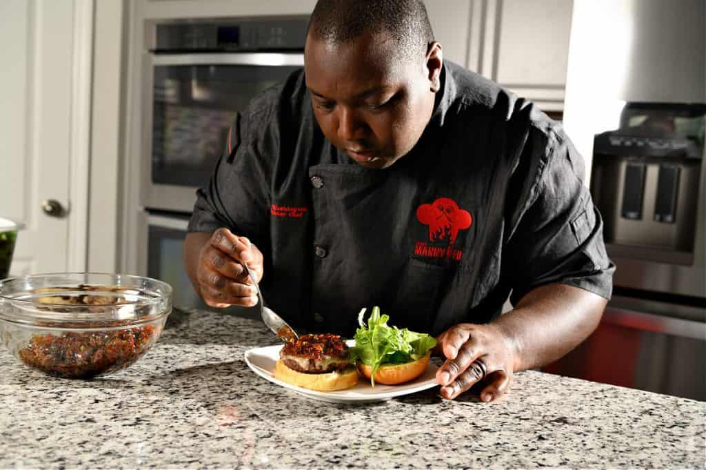 Chef Manny Washington focuses on creating the most delicious dishes in his firehouse kitchen