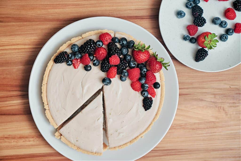 Raspberry Coconut Tart Filled with Coconut Pudding Topped with Berries prepared by Chef Amanda Smith